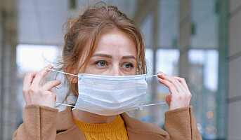 Halve befolkningen vil fortsette å bruke munnbind etter korona